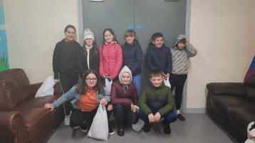 Young people deliver 'bags of happiness' to people living in Derry estate and help lift many people's spirits