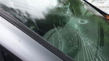 Number of cars hit by missiles thrown by youths on to a busy road in Derry