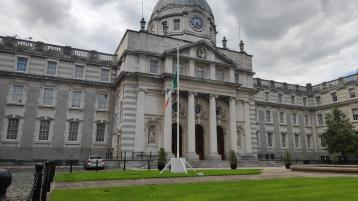 DEATH OF JOHN HUME: Flags at government buildings in Dublin fly at half mast in honour of former SDLP leader