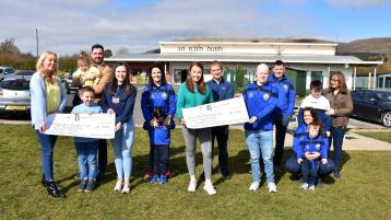 Cara and Orla hand over fundraising cheques