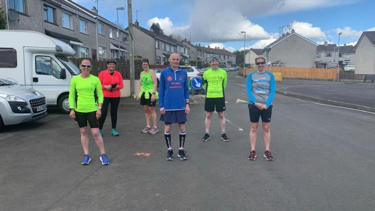 ATHLETICS: Local running coach takes on 50-mile charity challenge