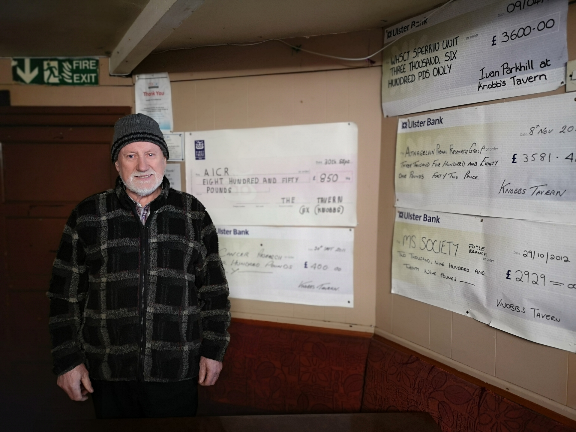 Mervyn McComb surveys the presentation cheques that hold pride of place in Knobbs'.